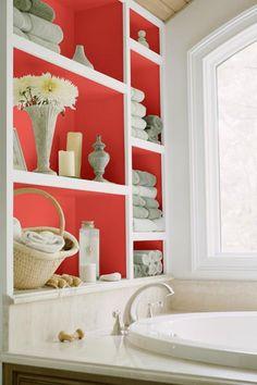 A shock of coral-radiance turns built-in bath storage into an artful tub-side display. Bath Girls, Kids Bath, Dutch Boy Paint, Laundry In Bathroom, Master Bathroom, Built In Bath, Bookcase Styling, Bath Storage, Relaxing Bath