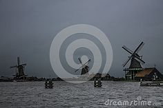 Three historic windmills on a cloudy day