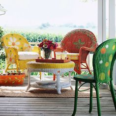 New outdoor furniture not in your budget? Use a vibrant palette of green, orange, yellow, white, and coral paint to pull together an assortment of mismatched wicker flea market pieces.