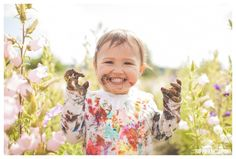 we love this adorable little face she is making during her family photo shoot in a flower field - she was covered in paint and this is her orgre face. Family Photography Seattle - the Happy Film Company