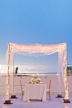 Having a sunset wedding? Loop them around a chuppah — it'll look lovely.  Photo by Jennifer Blair Photography via Style Me Pretty