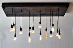 This 14 bulb industrial chic chandelier is versatile enough for restaurants, bars, retail spaces, and residences. It has a classic industrial look