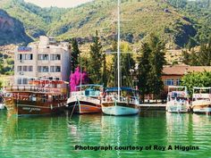 Boats moored at Fethyie in Turkey. The bougainvillea and the colour of the sea caught my eye. Photograph Roy a Higgins. Bougainvillea, My Eyes, Exploring, Boats, Turkey, Photograph, Colour, Sea, Places