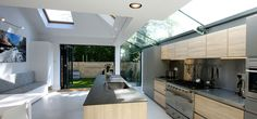 aluminium bi fold doors to the rear of modern extension with structural strip roof light over kitchen