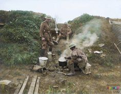 A Lewis machine gun post of the Tank Corps near Robecq, Nord-Pas-de-Calais, 17 April 1918.  Soldiers cooking their food during a quiet spell.  Near the limit of the British retreat during the German Spring Offensive, which lasted from March to April. They are far to the South East of Ypres.   (Photo source - © IWM Q 8722) (Photographer - Second Lieutenan David McLellan)  (Colourised by Royston Leonard from the UK)