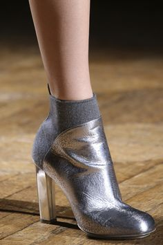 How clever???  a sock-like back of the boots for a sleeker look!  Dries Van Noten - Autumn/Winter 2014