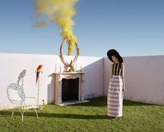 Kirsi Pyrhonen in stripes with parrot and yellow smoke, fashion by Jil Sander, Sennowe Park, Norfolk, 2010