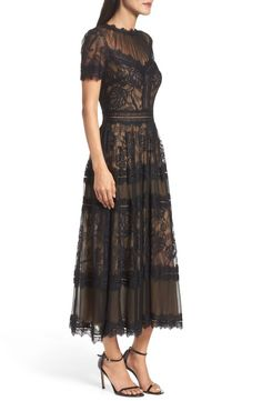 Both seductive and charming, this compelling lace dress offers the illusion of skin-baring allure and the ladylike refinement of a tea-length silhouette. Lace Tea Length Dress, Black Lace Midi Dress, Tea Length Wedding Dress, Tea Length Dresses, Boho Dress, Elegant Dresses, Pretty Dresses, Fabulous Dresses, Tall Girl Fashion