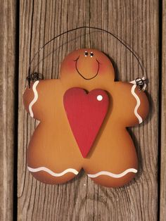 Hand painted Gingerbread Man with Heart Wood Ornament. $10.00, via Etsy.