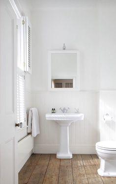 White & reclaimed wood bathroom. (Even love the vintage doorknob!)