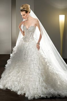 Jeweled Strapless with a sweetheart neckline Lace-up back and Multi-ruffled pleated tulle Skirt.