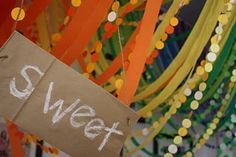 """Sweet color paper installation for engagement party. Snacks marked """"sweet"""" or """"salty."""""""