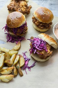 Is there anything better than fried chicken? How about buttermilk fried chicken sandwiches with cabbage slaw and sriracha mayo?