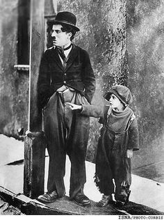 """Charlie Chaplin and Jackie Coogan, """"The Kid"""", The Kid is a 1921 silent film written, produced, directed by and starring Charlie Chaplin. This is his first feature film and also a masterpiece. Charlie Chaplin, Vintage Hollywood, Classic Hollywood, The Kid 1921, Charles Spencer Chaplin, Bon Film, Film Le, Silent Film, Old Movies"""