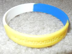 """Item #1293 ($1) – """"One cup at a time"""" band (Alex's Lemonade Stand)"""