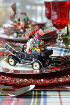 Merry Motoring Whimsical Christmas Table with Radko car ornaments | homeiswheretheboatis.net #Christmas #tablescape #tartan #plaid