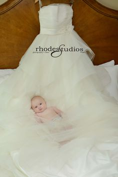 Brides precious baby snuggling in her wedding dress!