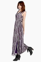Jail Break Maxi Dress: White and purple stripe maxi dress. Stretch band at waist. Fully lined. Features a slit on the side. Pair this with ankle boots and layered necklaces at the next music festival.