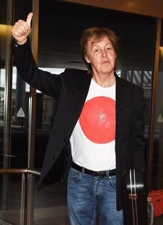 Macca's ready to rock. Paul McCartney arrives at Haneda Airport with his guitar and a winning attitude on May 15 in Tokyo