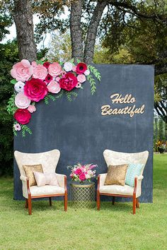Create a gorgeous photo area by adorning a wall with paper flowers in different…