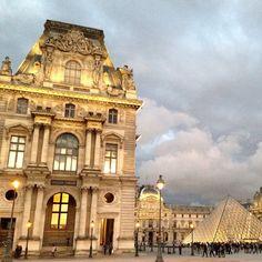 The Louvre's bright lights bring warmth to a dark Parisian sky. Photo courtesy of mashamtousi on Instagram.