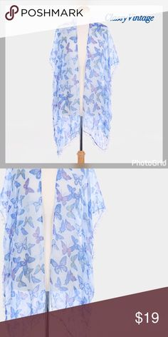 Blue kimono or beach cover Sheer  and light beautiful butterfly print Kimono or beach cover. This is 37X35 and is 100% viscose. Pom Pom trim for added fun boutique Swim Coverups