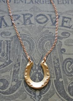 Lucky Horseshoe Necklace... Perfect Derby accessory!! Besides a large hat of course.