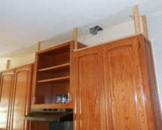 Add kitchen cabinets to low hanging cabinets - all the way to the ceiling - great tutorial!!