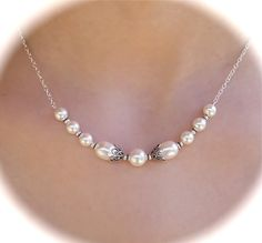 http://www.etsy.com/listing/85504904/pearl-bridal-necklace-antiqued-filigree