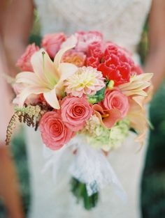 Pretty mix of peach & coral flowers for Bouquet -- See more on http://www.StyleMePretty.com/2014/03/31/colorful-outdoor-celebration-after-the-storm/ Photography: Sara Hasstedt - sarahasstedt.com #smp