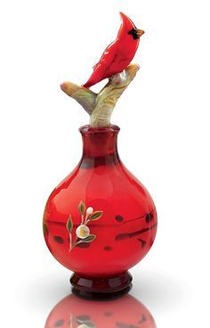 Vintage Red Cardinal topped perfume bottle.