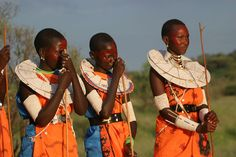Masai girls in Kenya, our safari beautiful, poised and dressed totally chic--do you just love those beaded cuffs?