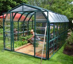 Rion Grand Gardener 2 - x - Hobby Greenhouse has a beautifully designed barn style shape. Rion x Gardener Greenhouse by AllSun Solar Products.