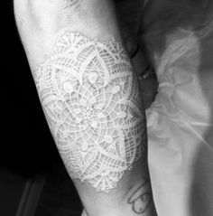 Lovely white ink lace tattoo. What a soft addition to the arm. http://thestir.cafemom.com/beauty_style/186324/12_gorgeous_delicate_white_tattoo