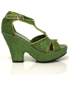Are these things made of snake skin??  That's what it looks like.  The shoe gets 9 for style and a 0 for material/color.