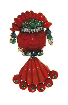 A coral and diamond pendant/brooch Designed as a Central American cultural…