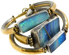 Judy Geib Plus Alpha - Opal and gold bracelets. The opal on the middle bracelet is carefully repaired, in the Japanese tradition for repairing heirloom ceramics, with a gold seam Opal Jewelry, Jewelry Art, Jewelry Bracelets, Jewelry Accessories, Fashion Accessories, Jewelry Design, Fashion Jewelry, Bangles, Jewellery