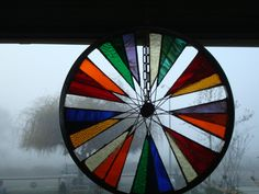 Old bycycle wheel turned stained glass yard art