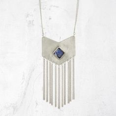 Eye-catching and powerful, the VIXEN fringe necklace is a perfect finishing touch to any look. Hand-cut and finished with a matte polish, this geometric sterlin
