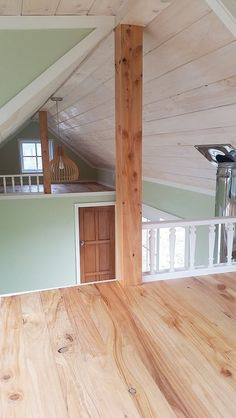 green tiny house. 2nd loft and bath door off liv space.