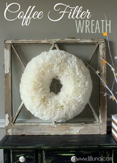Tea stained Coffee filter wreath. Boil a pot of water, add tea, soak coffee filters in hot tea until the color consistency you like.  Lay out separately to dry. Once fry, gather at center and using chop stick or similar item, poke filter into hay wreath.  Continue  until filters are thick and wreath is full.