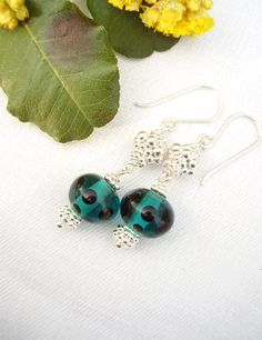 Elegant earrings in teal and black. Follow me at: http://www.facebook.com/Theresesmykker