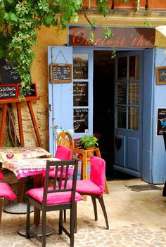 Colorful tea shop in Uzes, Languedoc Roussillion, France. This little French tea shop is such a cozy place to sit for a spell with a cup of jasmine green tea in my case. Uzes France, Provence France, Cafe Bistro, Cafe Bar, Deco Restaurant, Shop Fronts, French Countryside, Tea Time, Beautiful Places