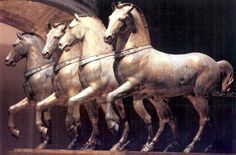 """""""Horses of Saint Mark"""" Basilica in Venice, is a set of Late Classical or Roman Imperial bronze statues, originally part of a monument depicting a quadriga (a four-horse carriage used for chariot racing). It is certain that the horses... were long displayed at the Hippodrome of Constantinople; they were looted by Venetian forces as part of the sack of the capital of the Byzantine Empire in the Fourth Crusade (1204). 