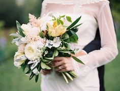 Ashley's maid of honor will carry a loose, naturally-shaped bouquet of white hydrangeas, white ranunculus, peachy yellow garden roses, white sweet peas, white astilbe, bay laurel, and silver dollar eucalyptus wrapped in nude ribbon with the stems showing.