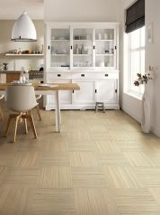 Square click-together tiles in a linear design, arranged horizontally and vertically, create a basketweave pattern. Shown: Forbo Marmoleum Click in Trace of Nature, $7 per sq. ft.; forboflooringna.com for dealers. Price does not include installation.