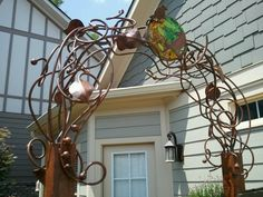 Twisted copper pipe arbor and bottle tree?