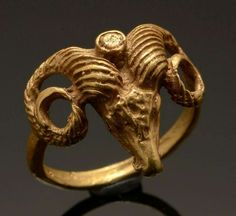A ring from the Roman Empire, dated to the – centuries AD. The head of a mountain goat – the horns are distinctive – but with the addition of a distinct crescent moon each side.