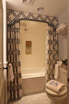 Liz Caan Interiors - bathrooms - white, blue, moorish, tiles, shower curtain, blue, walls, monogrammed, towels,  Chic small bathroom design with
