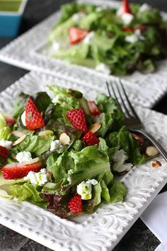 Strawberry & Goat Cheese Green Salad with Basil Vinaigrette    The vinaigrette:  10 large fresh basil leaves, thinly sliced  2 tbsp white wine vinegar  1/4 cup plus 2 tbsp extra-virgin olive oil  Salt and pepper to taste    The salad:  1/3 cup sliced almonds  6 cups (packed) torn red lettuce leaves  1 1/4 cups sliced fresh strawberries  2 oz. goat cheese, crumbled